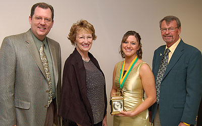 Tom Wheaton (left), director of Alumni Relations; Dr. Kay Schallenkamp, BHSU president; and Hugh Palmer, president of the BHSU Alumni Association; present the Spirit of BH Award to Lillian Bruckner at the 15th annual Student Volunteer Awards Celebration at Black Hills State University.
