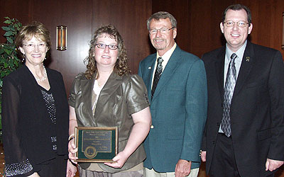 Stacy (Lowry) Geer (second from left) accepts the 2008 Young Alumni Achievement Award from Black Hills State University President Kay Schallenkamp, BHSU Alumni Association President Hugh Palmer, and BHSU Alumni Relations Director Tom Wheaton.