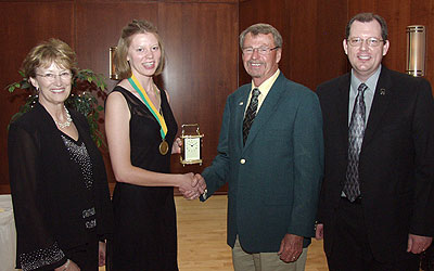 Black Hills State University President Kay Schallenkamp (left), Alumni Association President Hugh Palmer (second from right), and Alumni Relations Director Tom Wheaton present the Spirit of BH Award to Kelly Kirk, senior history major from Beulah, N.D., at the recent Student Volunteer Awards celebration.