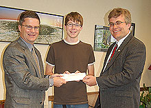 Jacob Bohlmann receives the Clarkson Memorial Scholarship from Jeb Clarkson and Steve Meeker