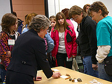 Dr. Holly Downing, dean of the College of Arts and Sciences at Black Hills State University, discusses social insect nest architecture and the various methods and building materials used in the construction process of those nests with attendees at the recent Women in Science Conference in Rapid City