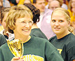 BHSU President Kay Schallenkamp presents the DAC Commissioner's Cup to Athletic Director Jhett Albers and all Yellow Jacket student-athletes