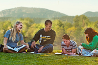 BHSU students studying on campus green