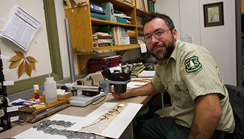 Rylan Sprague works as the Northern Hills District Botanist for the Black Hills National Forest.