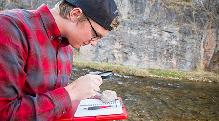 Student Studying Rock