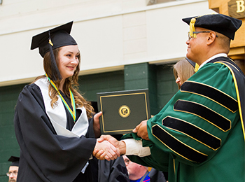 Graduating student receiving honors on her transcript